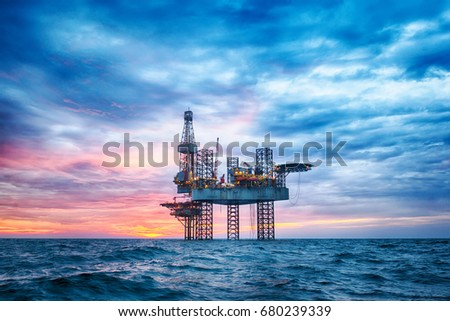 HDR of Offshore Jack Up Rig in The Middle of The Sea at Sunset Time  #680239339