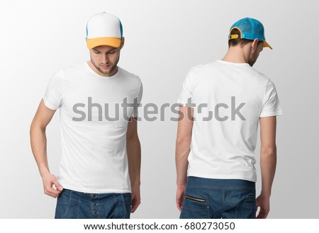 White t-shirt on a young man in jeans and cap, isolated, front and back, mockup. #680273050