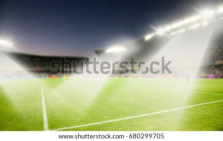 evening stadium arena soccer field with flood light - defocused background #680299705