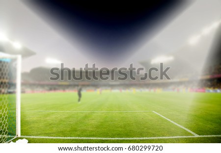 evening stadium arena soccer field with flood light - defocused background #680299720