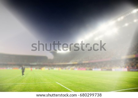 evening stadium arena soccer field with flood light - defocused background #680299738