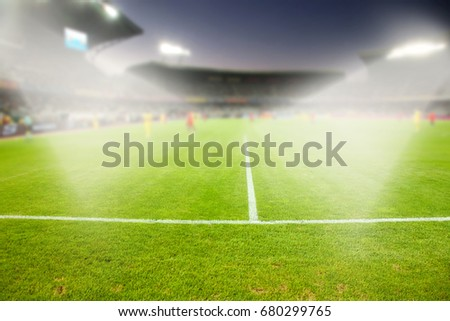 evening stadium arena soccer field with flood light - defocused background #680299765