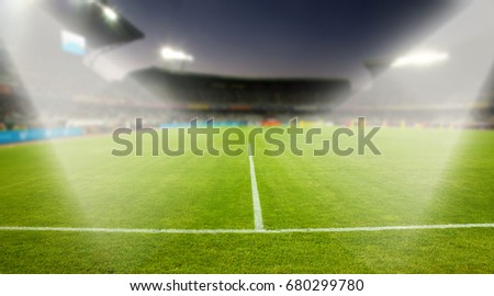 evening stadium arena soccer field with flood light - defocused background #680299780