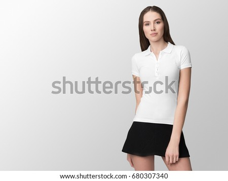 White polo on a young woman in black skirt, isolated, with copy space, mockup. #680307340