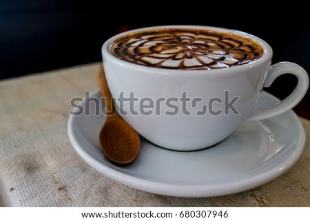 Hot cappuccino  coffee with spider web art milk on old wood table  #680307946