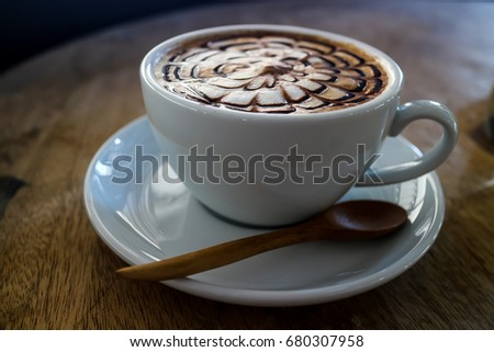 Hot cappuccino  coffee with spider web art milk on old wood table  #680307958