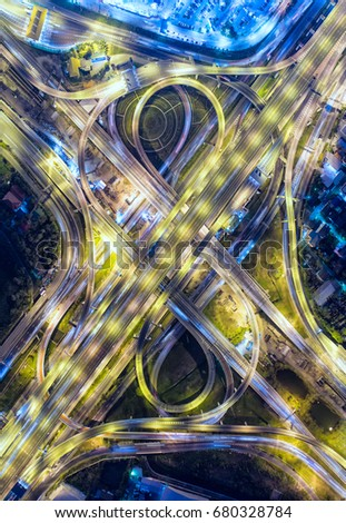 Aerial view, Road roundabout, Expressway with car lots in the city in Thailand.  beautiful Street , downtown, cityscape, Top view. Background #680328784