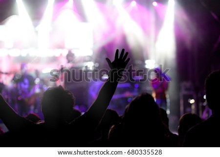 crowd with raised hands at concert - summer music festival #680335528