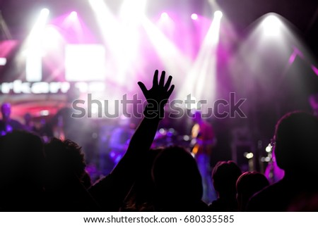 crowd with raised hands at concert - summer music festival #680335585