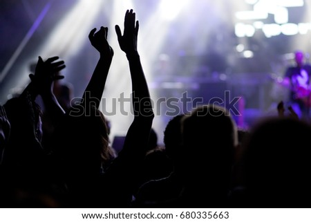 crowd with raised hands at concert - summer music festival #680335663