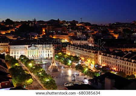 LISBON - JULY 2, 2017: Rossio Square is located in the Pombaline Downtown of Lisbon and has been one of its main squares since the Middle Ages. #680385634