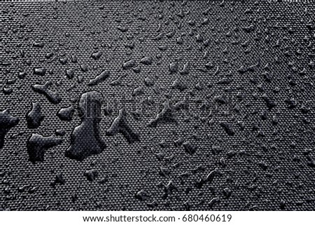 Drops of water on textile background.B&W photo. #680460619