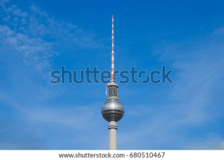 Berlin symbol: Tv tower isolated on blue sky #680510467