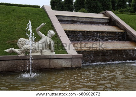 HILLEROD, DENMARK - JUNE 30, 2016: It is the fragment of fountain in Baroque-style Frederiksborg Castle Gardens.  #680602072