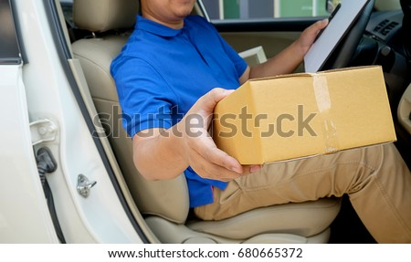 Delivery driver driving with parcels on seat #680665372
