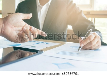 Business executives working on laptop with data document at the office #680739751