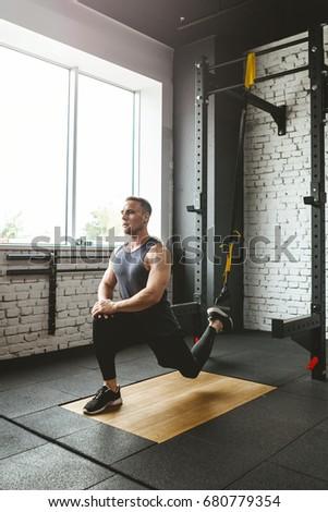 Man in sportswear exercising at gym #680779354
