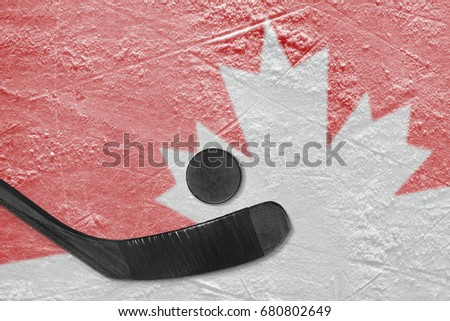 Hockey puck, putter and image of the Canadian symbol on ice. Concept, hockey