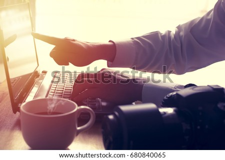 Man hand is using laptop and pointing on screen. Soft focus on hand. #680840065
