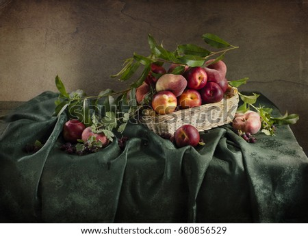 Still life with ripe peaches, berries lying on the table #680856529