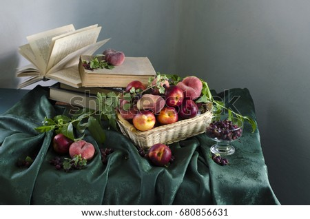 Still life with ripe peaches, berries lying on the table #680856631