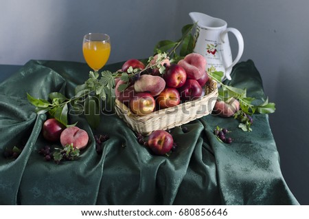 Still life with ripe peaches, berries lying on the table #680856646