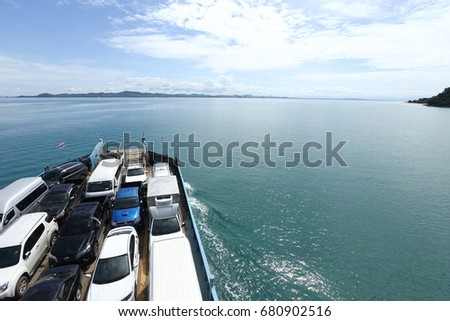 Trat, Thailand - July 3, 2017 ;  Ferry Carry car vehicles acroos Thai Bay to Koh Chang Island in beautiful sunshine day green ocean #680902516
