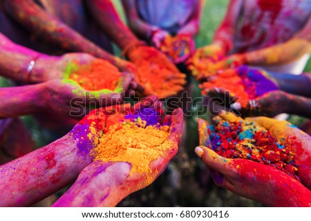 close-up partial view of young people holding colorful powder in hands at holi festival  Royalty-Free Stock Photo #680930416