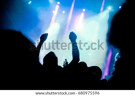 crowd with raised hands at concert - summer music festival #680975596