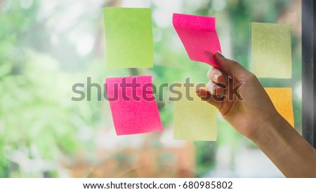 Business people using sticky note on glass wall background to share idea and brainstorming for discussing and planning concept #680985802