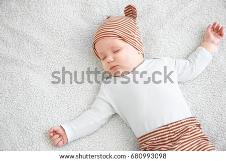 Cute little baby sleeping on plaid at home #680993098