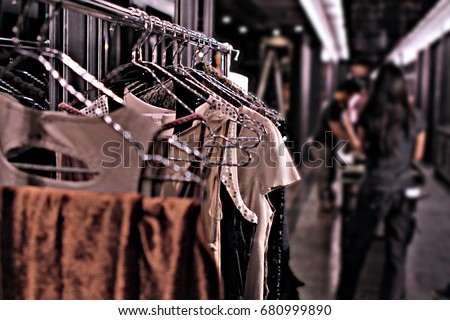 a hanging clothes rack put in the corridor in backstage of fashion show #680999890