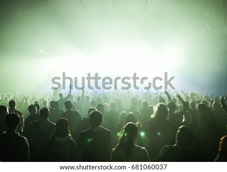 MOSCOW-20 FEBRUARY,2015: Crowded dancefloor in nightclub.Big live music show in the club.People have fun on concert.Big crowd on sold out festival.Rave party people on dance floor.Techno music party #681060037