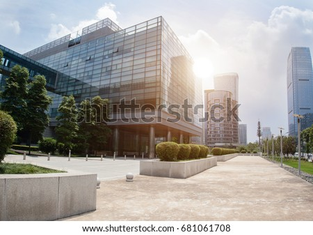 empty footpath with modern office building exterior  and blue cloudy sky during sunrise #681061708