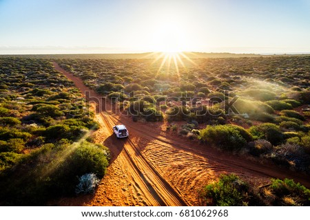 Australia, red sand unpaved road and 4x4 at sunset, Francoise Peron, Shark Bay Royalty-Free Stock Photo #681062968