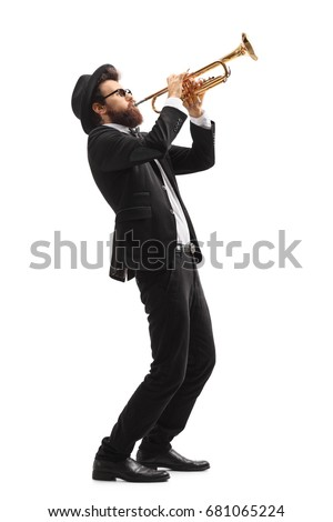 Full length profile shot of a musician playing a trumpet isolated on white background Royalty-Free Stock Photo #681065224
