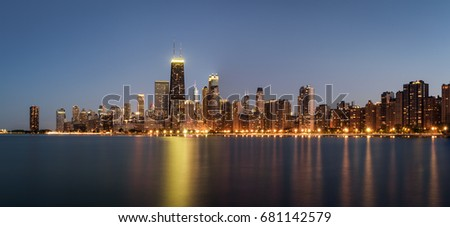 Chicago skyline panorama across Lake Michigan at night viewed from North Avenue Beach. Long exposure. #681142579