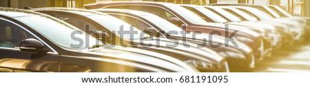 luxury Cars For Sale Stock Lot Row. Car Dealer Inventory. Cars For Sale Stock Lot Row. Car Dealer Inventory. sunset sun rays light. sun beam Royalty-Free Stock Photo #681191095