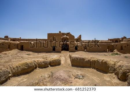 ancient caravanserai in desert iran with blue sky #681252370
