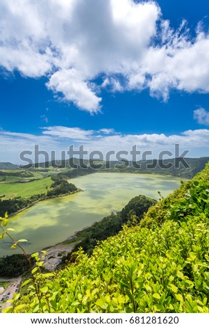 Furnas Lagoon in the Azores. Furnas is located in the easternmost of three active trachytic volcanoes on the island of São Miguel, in the historically active Volcanic Complex of Furnas.  #681281620
