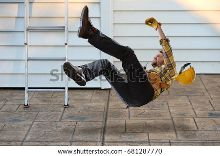 Worker with hard hat falling from ladder onto concrete floor Royalty-Free Stock Photo #681287770