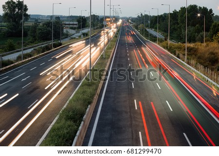 Car traffic lights at evening on a highway #681299470