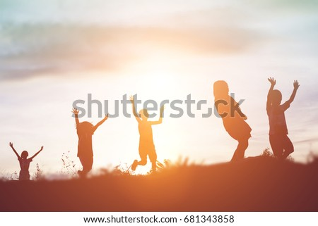 silhouette of a happy children and happy time sunset #681343858