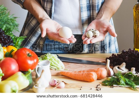 Woman cook at the kitchen, soft focus background #681428446