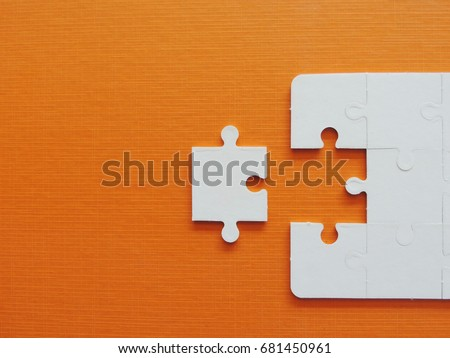 Puzzle jigsaw on orange background. #681450961