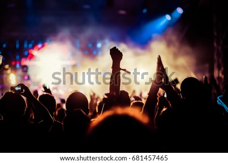 crowd with raised hands at concert - summer music festival, nightclub, party #681457465