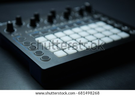 Drum machine midi controller for disc jockey,sound producer & composer.Create electronic musical tracks with modern digital beat machine.Professional drum machine for producing digital music #681498268