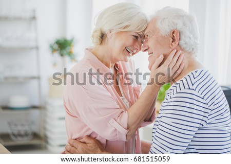 Senior couple holding each other at home #681515059