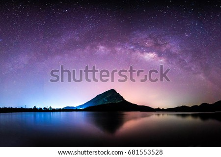 night landscape mountain and milkyway  galaxy background , thailand , long exposure ,low light   Royalty-Free Stock Photo #681553528