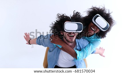 Happy multiethnic couple getting experience using VR headset glasses of virtual reality, isolated on white background #681570034